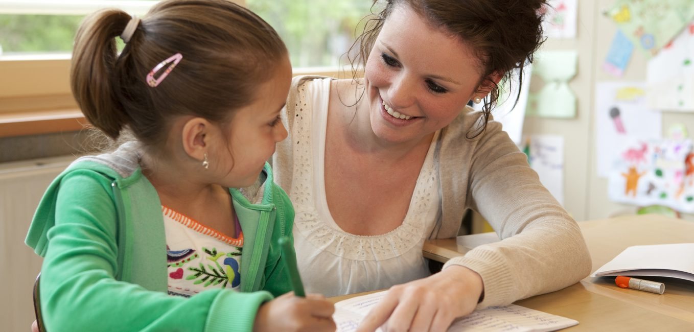 Mom Teaching Kid To Read At Early Age